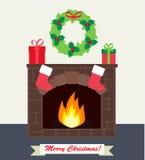 Camino con i regali e le calze di Natale Fotografia Stock Libera da Diritti