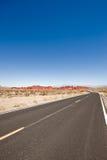 Camino con paisaje del desierto Imágenes de archivo libres de regalías