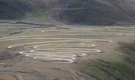 Camino de enrollamiento en montañas Fotografía de archivo libre de regalías