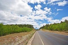 Camino de la autopista sin peaje Imagenes de archivo