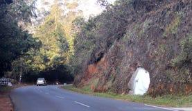 Camino de la colina con el coche Fotos de archivo libres de regalías