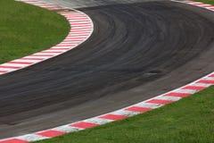 Camino de la curva del circuito de carreras Fotografía de archivo libre de regalías