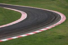 Camino de la curva del circuito de carreras fotografía de archivo