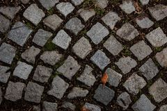 Camino de la piedra de pavimentación, piedras de la textura, fondo de piedras viejas Pavimento viejo Foto de archivo
