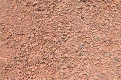 Camino de pequeñas piedras rojas Imagen de archivo