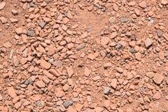 Camino de pequeñas piedras rojas Fotos de archivo libres de regalías