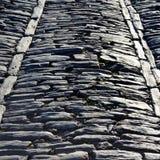 Camino de piedra antiguo medieval imagen de archivo