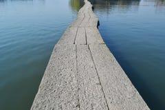 Camino de piedra en el río Fotos de archivo