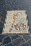 Camino de santiago pilgrimage symbols crook calabash canteen and. Shepherd crook, calabash canteen and scallop shell in a mosaic marking the way to pilgrims in Royalty Free Stock Photos