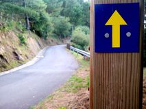 Camino de Santiago (Way of St. James) Yellow arrow. Stock Image