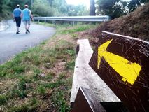 Camino de Santiago (Way of St. James) Yellow arrow. Royalty Free Stock Images