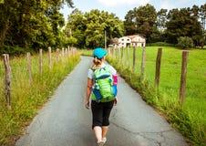 Camino de Santiago. Woman walking on Camino de Santiago Stock Image