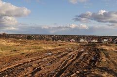 Camino de tierra del país en la puesta del sol Fotografía de archivo libre de regalías