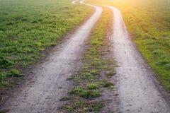 Camino de tierra en la luz del sol Fotografía de archivo