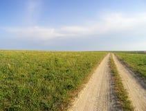Camino de tierra en los prados Fotografía de archivo