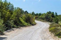 Camino de tierra que da vuelta a la izquierda Imagenes de archivo