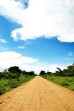 Camino de tierra recto Imagen de archivo libre de regalías