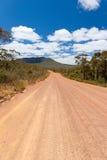 Camino de tierra rojo imagen de archivo