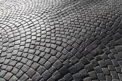Camino del adoquín, pavimento de piedra de la calle Fotografía de archivo