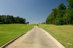 Camino del carro de golf Imagen de archivo libre de regalías