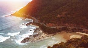 Camino del océano en puesta del sol Foto de archivo libre de regalías