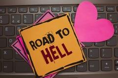 Camino del texto de la escritura de la palabra al infierno El concepto del negocio para el viaje inseguro aventurado oscuro del c foto de archivo
