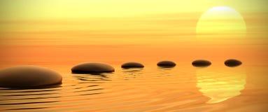 Camino del zen de piedras en puesta del sol en con pantalla grande Imagen de archivo