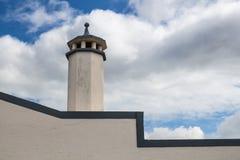 Camino e un cielo nuvoloso Fotografie Stock