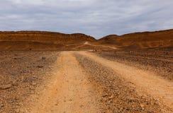 Camino en el desierto Imagen de archivo libre de regalías