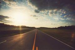 Camino en la puesta del sol Foto de archivo libre de regalías