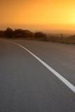 Camino en la puesta del sol Imágenes de archivo libres de regalías