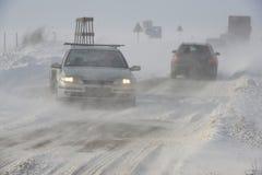 Camino en tormenta de la nieve Fotos de archivo libres de regalías