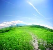 Camino en un valle de la montaña Foto de archivo libre de regalías