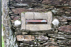 Camino mail box. A old mail box with the shell in a house along the camino de santiago pilgrimage way in spain Royalty Free Stock Photo
