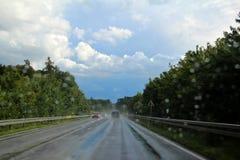 Camino mojado Imagen de archivo