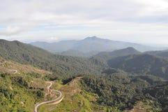 Camino montañoso de enrrollamiento Imágenes de archivo libres de regalías