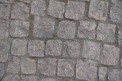 Camino pavimentado con los adoquines rectangulares del granito Fotografía de archivo libre de regalías
