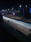 Camino por noche Foto de archivo libre de regalías