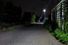 Camino rural oscuro imagenes de archivo