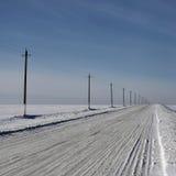 Camino septentrional vacío del invierno Imágenes de archivo libres de regalías