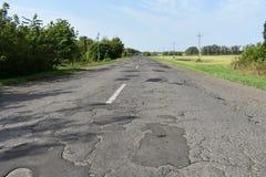 Camino viejo del asfalto de tierra del camino Fotos de archivo libres de regalías