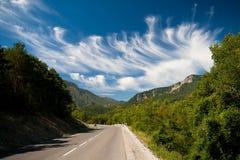 Camino y nubes Foto de archivo