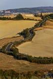 Caminos de enrollamiento toscanos foto de archivo
