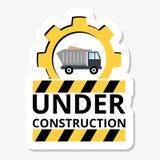 Camion avec le signe en construction de sable Photos libres de droits