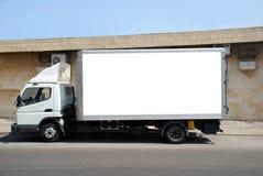 Camion blanc avec le panneau blanc Photographie stock
