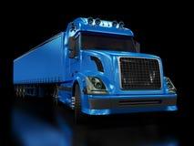 Camion bleu lourd d'isolement sur le noir Image libre de droits