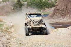 Camion dans un chemin tous terrains Photographie stock