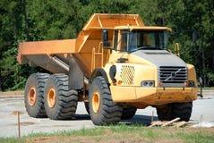 Camion de déchargeur au chantier de construction Photographie stock