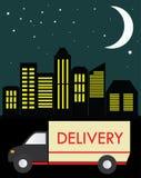 Camion de livraison sur un fond de la ville la nuit Photo stock