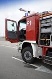 Camion dei vigili del fuoco con la porta aperta Fotografia Stock Libera da Diritti